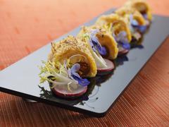 Fried fish skin on black plate in asian restaurant Kuvituskuvat