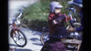 1953: childrens are playing when cycling WISCONSIN Stock Footage