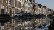 Houses along canal with reflection,Gouda,Netherlands Stock Footage