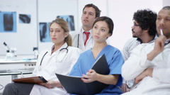4K Medical staff listening to lecture & asking questions at medical conference Stock Footage