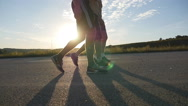 Male feet is walking on a rural road at sunset, close up. Slow motion Stock Footage