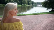 Pregnant woman in a yellow dress walkin Stock Footage