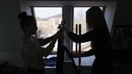 Women are steaming pants in model school Stock Footage