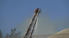 Fireman climbing down an extended ladder Stock Footage