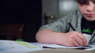 4k Authentic Shot of a Child Doing his Homework, dolly camera Stock Footage