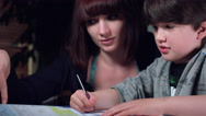 4k Authentic Shot of a Child Doing his Homework and Mum Helping Positive Stock Footage