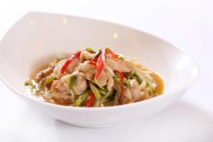 Special chicken salad with onion, chili and herbs on white bowl Stock Photos