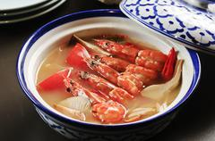 Shrimp soup with mushroom in Chinese style on bowl Stock Photos