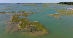 Flying across sand banks and rock outcrops Stock Footage