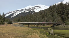 Automobile crossing Mountain Scenery Bridge. Stock Footage