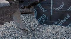 Back Hoe Tractor Bucket Dumping Gravel Rock Stock Footage