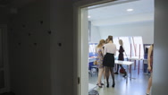 Group of girl prepares for going out in dressing room Stock Footage
