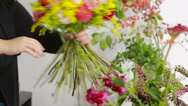 Florist prepares a bouquet of flowers for sale to customers Stock Footage