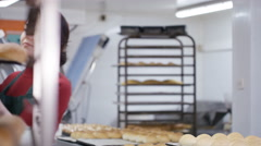 4K Portrait smiling young worker in bakery kitchen Stock Footage