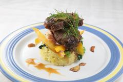 Turmeric rice junior beef short ribs with rice on plate Stock Photos