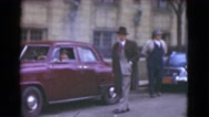 1939: men wearing overcoats, three-piece suits and hats in a downtown business Stock Footage