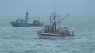 Commercial Fishing Boats Working In Increasingly Stormy Seas Stock Footage