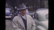 1939: man looking for his car LOS ANGELES, CALIFORNIA Stock Footage