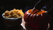 Scooping meat from pumpkin and shake it out Stock Footage