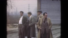1939: 11 men standing outside in the snow next to a railroad talking. LOS Stock Footage