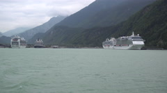 Cruise Ships sitting at Port in Mountainous Area Stock Footage