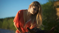 Close-up a sexy beautiful young woman riding a horse at a beach Stock Footage