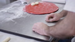 4K Close up on hands, man rolling out balls of dough in a bakery shop Stock Footage