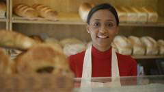 4K Friendly worker in bakery shop serving customer at the counter Stock Footage