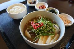 Korean clams soup with tofu and onion on wooden tray with rice Stock Photos