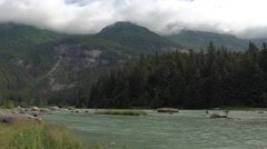 Fishermen and Young Boy on Banks of Salmon Infested River Stock Footage