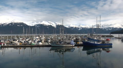 Fishing Boat Harbor and Snow Covered Mountains Time Lapse Stock Footage