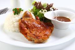 Vietnamese ribs broken rice or com tam suon on white plate Stock Photos