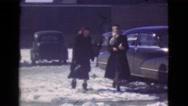 1939: women walking past cars LOS ANGELES, CALIFORNIA Stock Footage