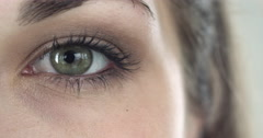 Extreme close-up of a green eye of a girl Stock Footage