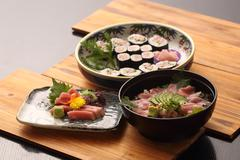 Tuna cuisine in Japanese style on wooden tray in restaurant Stock Photos