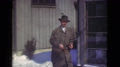 1939: man off to work, what a gentleman. look at those cars! LOS ANGELES, Stock Footage