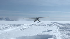 High Mountain Plane Taxi In Snow Stock Footage