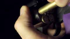 Loading 357 Magnum Ammo Into A Revolver Stock Footage