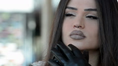 Woman with gloves and unique fleshy lips  Stock Footage