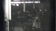 1939: men at work in spacious factory where heavy equipment is in use and safety Stock Footage