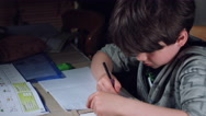 4k Authentic Shot of a Child Doing his Homework Maths Stock Footage