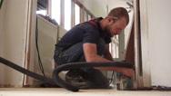 Man Operating Belt Sander Home Remodel Stock Footage