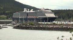 Massive Alaska Cruise Ship Dwarfing Small Boat Harbor Stock Footage