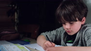 4k Authentic Shot of a Child Doing his Homework Stock Footage