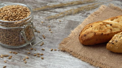 Fresh bread on the kitchen table. Healthy eating and traditional bakery concept Stock Footage