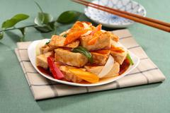 Sue fried tofu hot water with chili and onion on white plate on tablecloth Stock Photos