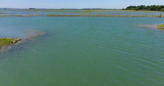 Flying over sand banks and rock outcrops Stock Footage