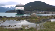Massive Cruise Ship Dwarfs Small Town Dock Stock Footage