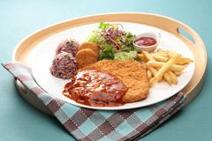 Assorted pork cutlet with cripsy potato, rice, salad and chili sauce on woode Stock Photos