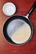 Bowl rice and pan Stock Photos